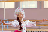 Artistic young ballerina posing in Russian costume — Stock Photo