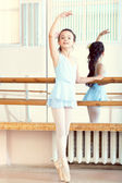 Ballet class. Cute little brunette warming up — Stock Photo
