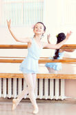 Artistic girl posing at camera in ballet class — Stock Photo