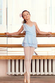 Image of petite ballerina posina at camera — Stock Photo