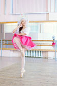 Graceful ballerina dancing in Russian costume — Stock Photo