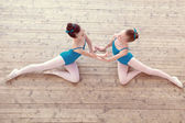 Top view of petite ballerinas dancing in studio — Stock Photo