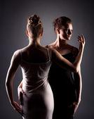Portrait of sexy female dancers hugging in studio — Stock Photo