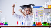 Serious little girl looking at color of reagent — Stock Photo