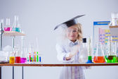 Little experimenter looks for evaporation reagent — Stock Photo