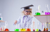 Pretty smiling girl working with reagents in lab — Stock Photo