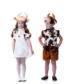 Funny little kids posing in carnival costumes — Stock Photo