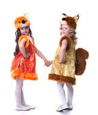 Cute young friends posing in carnival costumes — Stock Photo