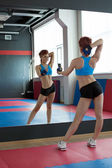 Slim girl photographing herself in fitness center — Stock Photo