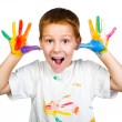 Smiling boy with hands in paint — Stock Photo