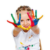 Little girl with ​​hands in paint — Foto de Stock