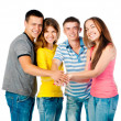 Group of young holding hands — Stock Photo #12583422