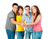 Group of young holding hands — Stock Photo