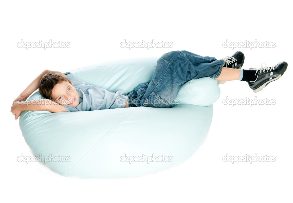 Smiling Boy on armchair over white background — Stock Photo #12738616