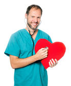 Doctor examining a red heart — Stock Photo