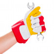 Gloved hand with wrench — Stock Photo