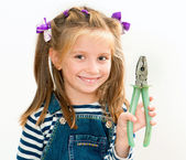 Smiling girl with pliers — Stock Photo