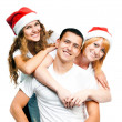 Foto Stock: Teenagers in Santa hat