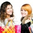 Teenage girls with shopping bags — Stock Photo