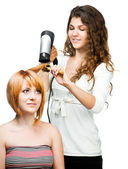 Hairdresser with hair dryer — Stock Photo