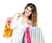 Pretty young woman holding shopping bags — Stock Photo