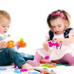 Kid playing toys — Stock Photo #14459143