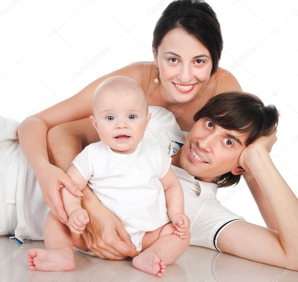 Portrait of a happy family smiling on a white background — Stock Photo #14460037