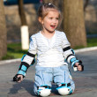 Stock Photo: Little girl in roller skates