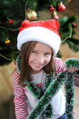 Little girl with santa hat — Stock Photo