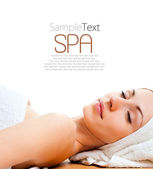 Young woman lying relaxed in the spa — Stock Photo