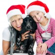Family inSanta hats — Stock Photo