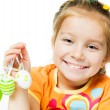 Happy little girl with easter eggs. - Stock Photo