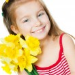 Happy little girl with flowers — Stock Photo