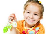 Happy little girl with easter eggs. — Stock Photo