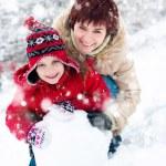 Happy family with snowman — Stock Photo #19257771