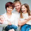 Pretty smiling family looking at the camera — Stock Photo