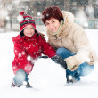 Happy family with snowman — Stock Photo #19257175