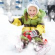 Girl sledding - Stock Photo
