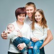 Nice smiling family looking at the camera — Stock Photo