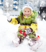 Girl sledding — Stockfoto