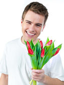 Man with a bouquet of tulips — Stock Photo