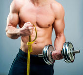 Man measuring bicepsc — Stock Photo