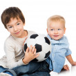Brothers with a soccer ball — Stock Photo