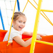 Little girl on a playground - Stock Photo