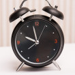 Black alarm clock — Stockfoto
