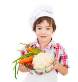 Boy with vegetables — Stock Photo