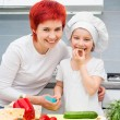 Mother and daughter in the kitchen — Stock Photo #23557371