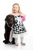 Little girl with retriever — Stock Photo