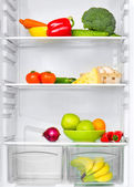 Refrigerator with vegetables — Stock Photo