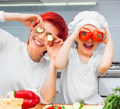 Mother and daughter in the kitchen — Foto de Stock